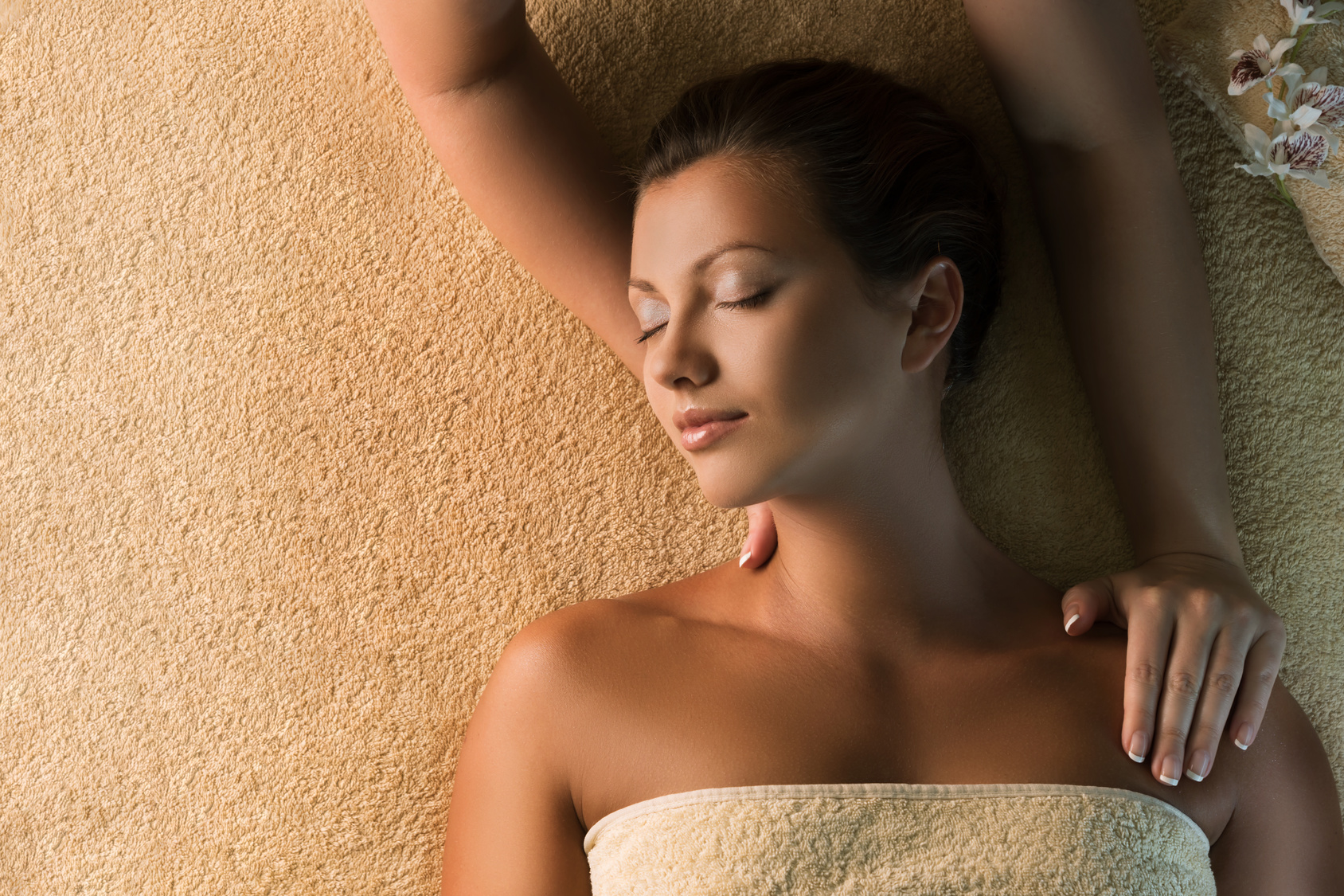 The beautiful girl has relaxing massage. Spa treatment
